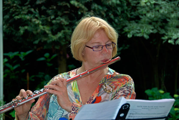 nancy on flute outside
