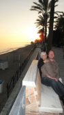 richard and xie  enhoying sunset in marbella